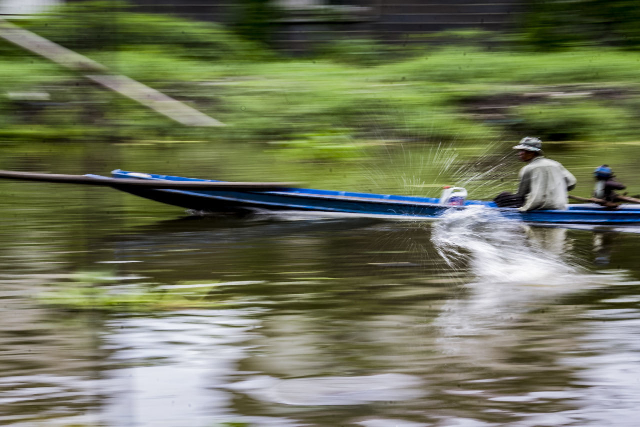 oar, river, real people, water, nautical vessel, day, adventure, one person, outdoors, waterfront, men, transportation, motion, nature, sitting, kayak, rowing, adult, people