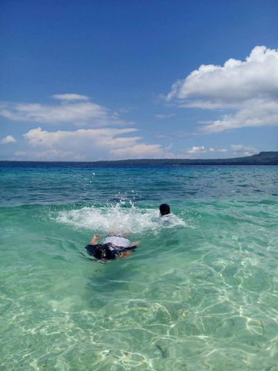 Water fun at Salagdoong Beach and Resort. My kids having fun in a clear blue water on a weekend getaway. Its more fun in the Philippines. EyeEmNewHere EyeEm Nature Lover Sea Sky Horizon Over Water Water Cloud - Sky Nature Beach Scenics Beauty In Nature Day Outdoors Blue Vacations Wave Eduardocabo Siquijor, Philippines Shiela2074 Luvuhuneko2074 Seaphotography Seaphoto Ocean Waves Splashing Water Fun Sunny Day Connected By Travel