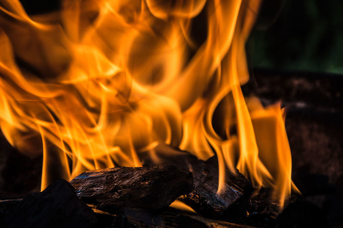 Abstract Arts Culture And Entertainment Backgrounds Black Background Burn Burning Close-up Coal Detail Extreme Close Up Fire Fireplace Focus On Foreground Glowing Human Hand Ideas Large Group Of Objects Night Outdoors Part Of Preparation  Selective Focus Simplicity Still Life Studio Shot