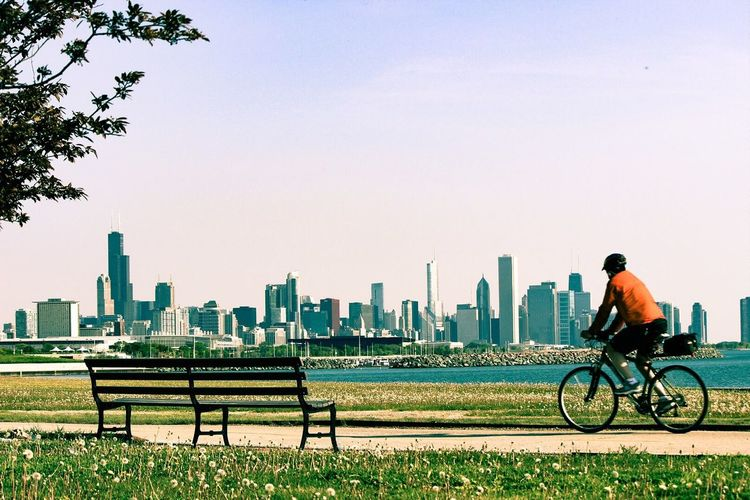 View of man riding bicycle in city