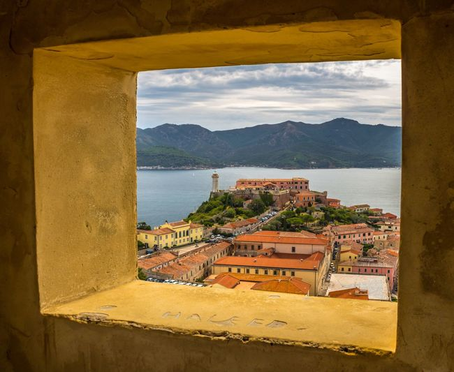 Looking out of Naploeon's window Elba Island  Portoferraio Italia Italy Nature Landscape_Collection Getty Images EyeEm Selects EyeEm Nature Lover EyeEm Gallery EyeEm Best Shots Water Architecture Built Structure Sea Nature Mountain Sky No People Building Exterior Scenics - Nature Day Beauty In Nature Building Outdoors City Cityscape Window Cloud - Sky Land