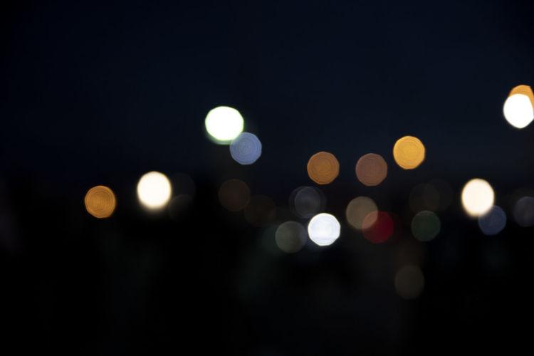 Illuminated Night Defocused Circle Geometric Shape Lighting Equipment Shape Glowing No People Light Light - Natural Phenomenon Street City Backgrounds Lens Flare Street Light Electric Light Outdoors Pattern Abstract Dark Vehicle Light Bokeh Bokehlicious Bokeh Photography