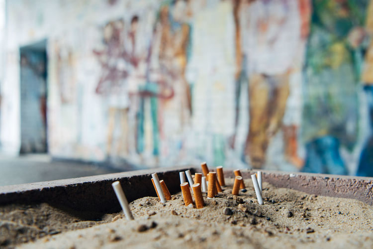 Close-up of cigarette against wall