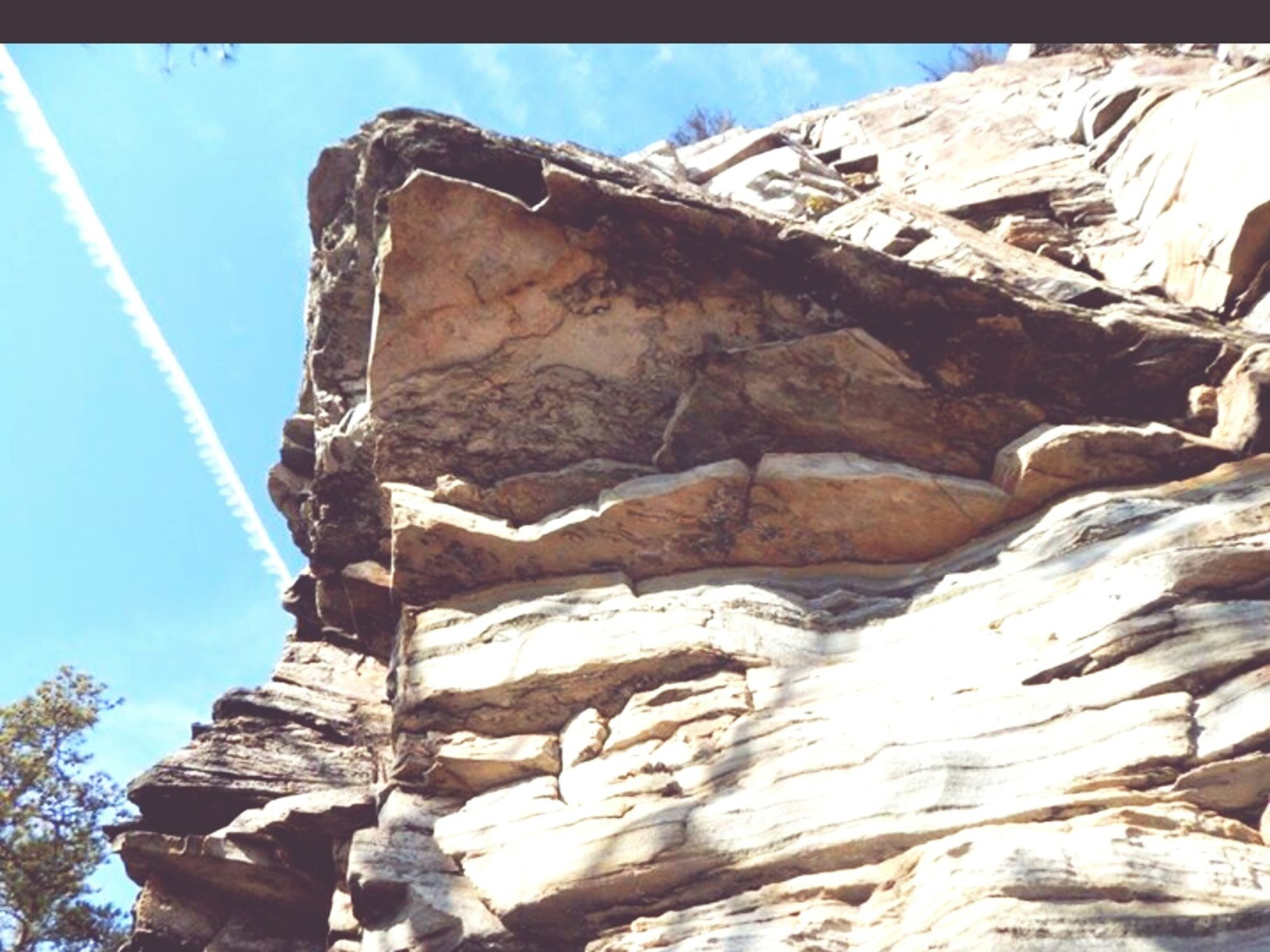 low angle view, rock formation, mountain, rock - object, sunlight, rocky mountains, sky, clear sky, blue, nature, rock, day, tranquility, rocky, outdoors, no people, built structure, beauty in nature, geology, physical geography