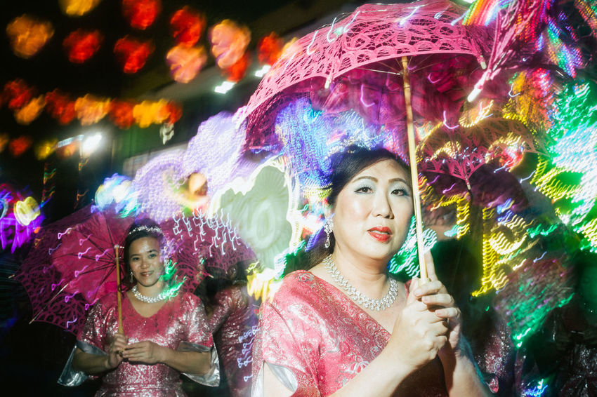 Chinatown, Singapore. 2017 © Chit Min Maung http://www.cmmaung.me/ The Chingay parade, the annual largest street performance and float parade in Asia, appeared in Chinatown, Singapore this year to bring thee celebrations to a great height but also marking the end of the Chinese New Year Celebrations. Adult Beautiful People Beautiful Woman Beauty Celebration Chingay2017 Cmmaung Cmmaungme Flash Flash Photography Fun Happiness Headshot Looking At Camera Multi Colored Night Only Women Outdoors People Portrait Smiling Streetphoto_color Streetphotography The Portraitist - 2017 EyeEm Awards The Week On EyeEm