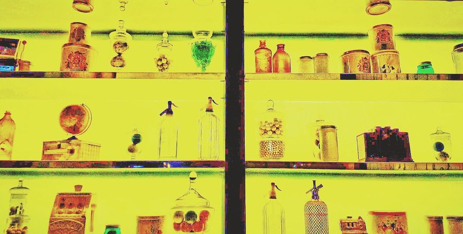 Everything In Its Place Neat And Tidy Shelves Bottle Collection Pairs Vibrant Colors Modern Bottles Glass Glass Container