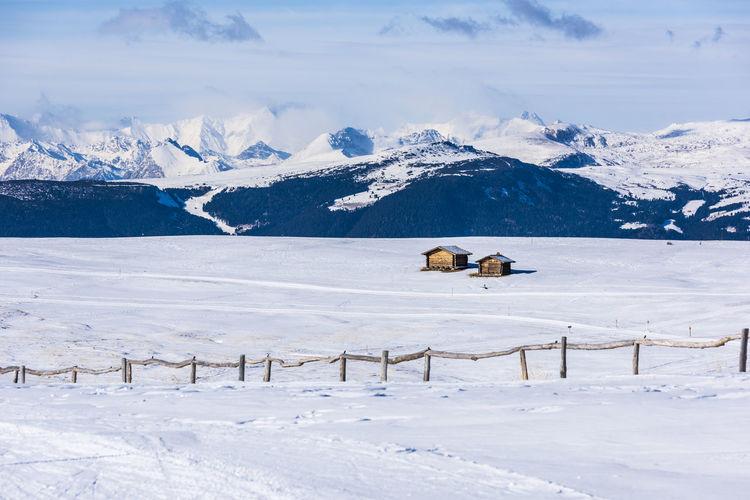 Dream huts on the alpe di siusi. in the white. dolomites, italy