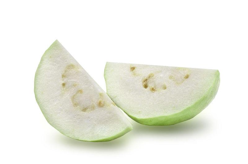 Close-up of lemon slice over white background