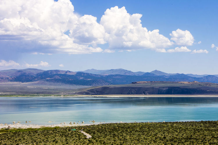 Mono Lake, a large, shallow saline soda lake in Mono County, California, with tufa rock formations Beauty In Nature Cloud - Sky Day Lake Landscape Mono Lake Mono Lake California Mountain Mountain Range Nature No People Outdoors Scenery Scenics Sky Tranquil Scene Tranquility Tufa Water