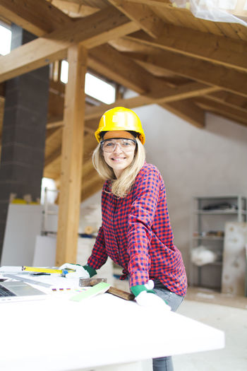Portrait of smiling woman working at construction site