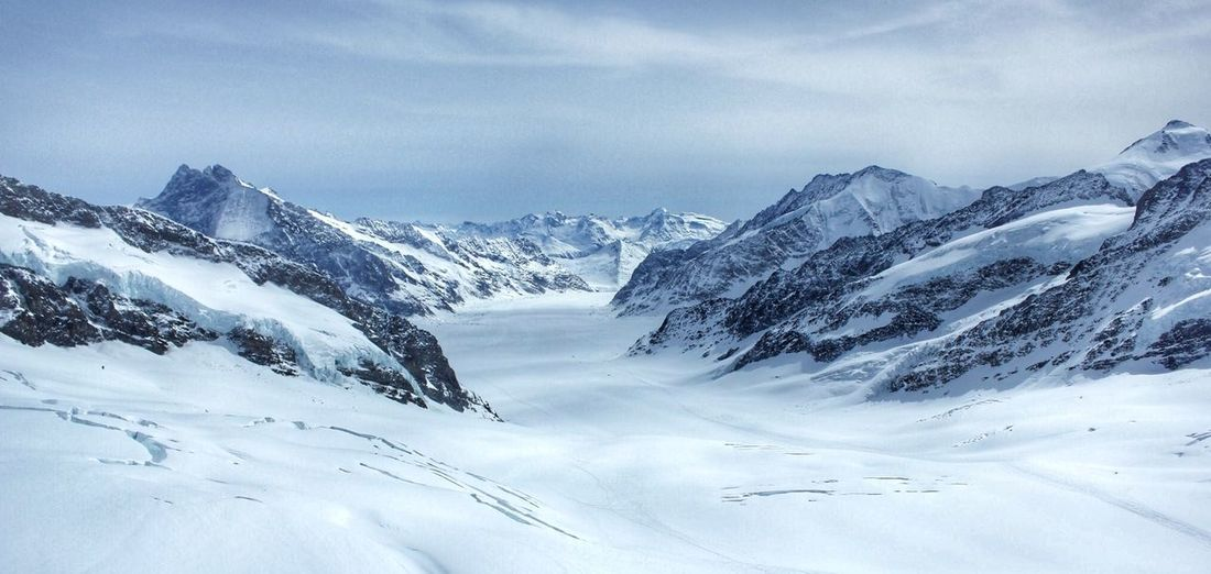 View from the top of Jungfrau in the Alps Alps Cold Temperature Frozen Glacier Hills Jungfrau Landscape Mountain Mountain Range Mountains Nature Sky Snow Snowcapped Snowcapped Mountain Switzerland Tranquility Trees View Winter