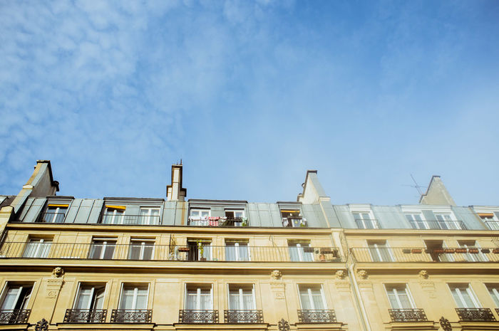 Low angle view of parisian old building with famous mansarde roof and windows Architecture Architecture Blue Building Exterior Built Structure City Day France Low Angle View Mansard Roof No People Outdoors Paris Paris ❤ Paris, France  Roof Sky Sky And Clouds Travel Destinations Windows Place Of Heart