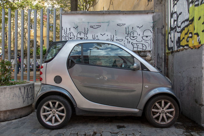 Smart Architecture Building Exterior Built Structure Car City Communication Day Graffiti Land Vehicle Mode Of Transportation Motor Vehicle Nature No People Outdoors Sign Street Text Transportation Wall Western Script