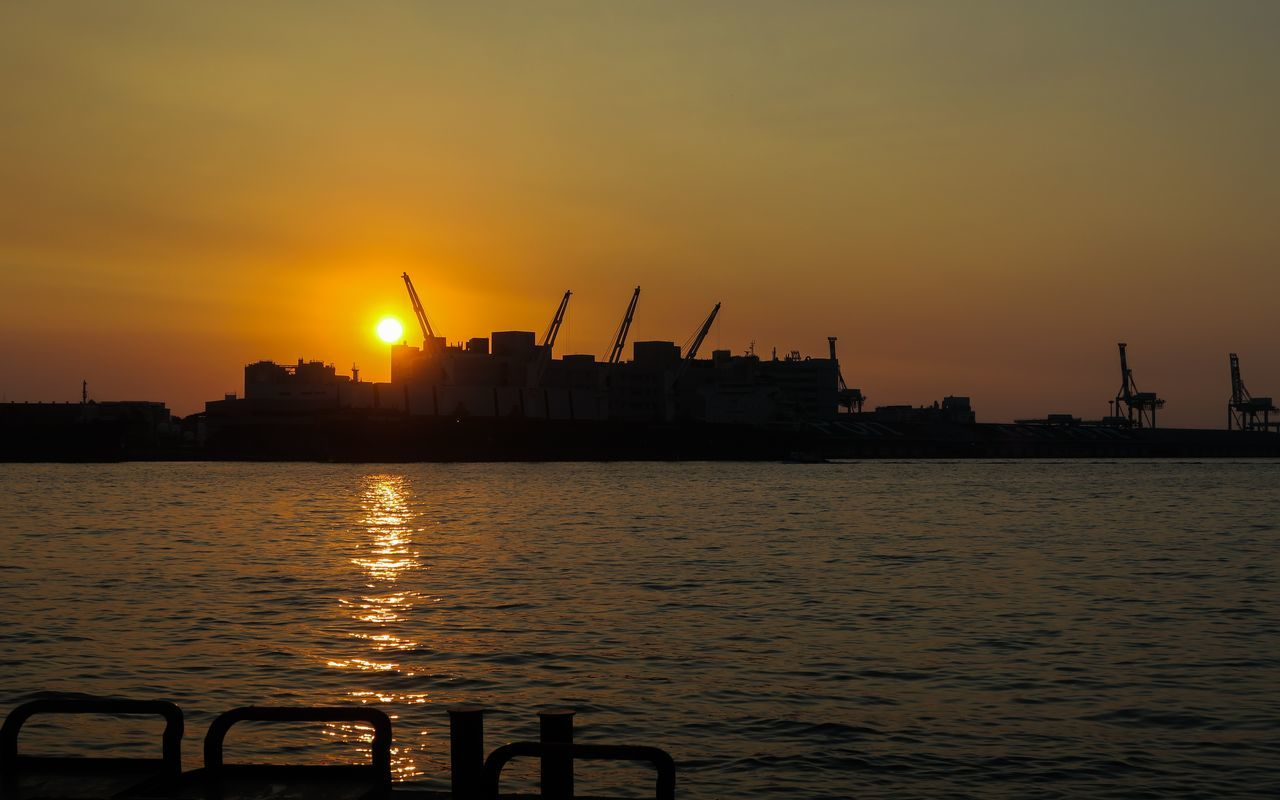 Silhouette Of City At Waterfront