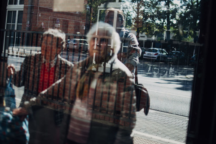 People in city street seen through glass