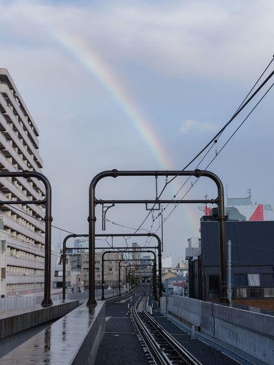 View of rainbow over city