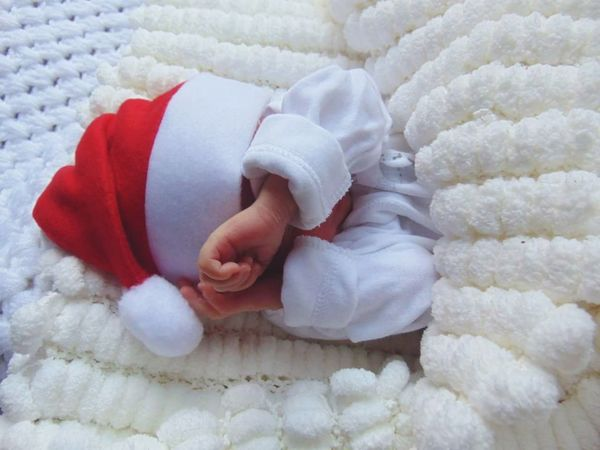 Baby Lying Down Babies Only One Person Newborn Santa Santa Claus Santa Hat Christmas New Baby Baby's Hand Baby's First Christmas