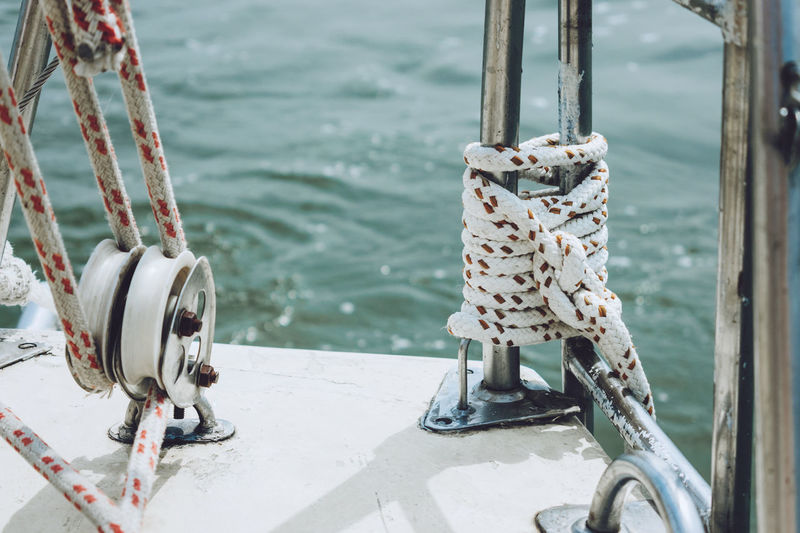 Close-up of tied up of metal chain on sea