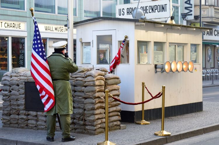 The Week On EyeEm Real People Text Architecture Built Structure Building Exterior Standing Patriotism One Person Full Length Day Outdoors Men City Adult Adults Only People Checkpointcharlie Berlin