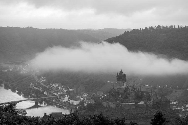 Aerial view of castillo de cochem in foggy weather