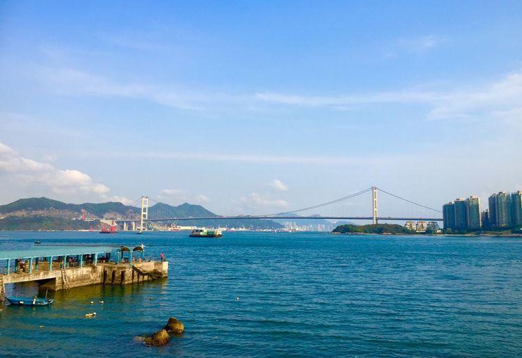 Tsing ma bridge over river against sky