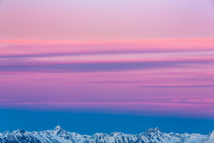 Beauty In Nature Cloud - Sky Cold Temperature Dawn Environment Idyllic Landscape Mountain Nature No People Non-urban Scene Pink Color Scenics - Nature Sky Snow Snowcapped Mountain Sunrise Sunset Tranquil Scene Tranquility Winter
