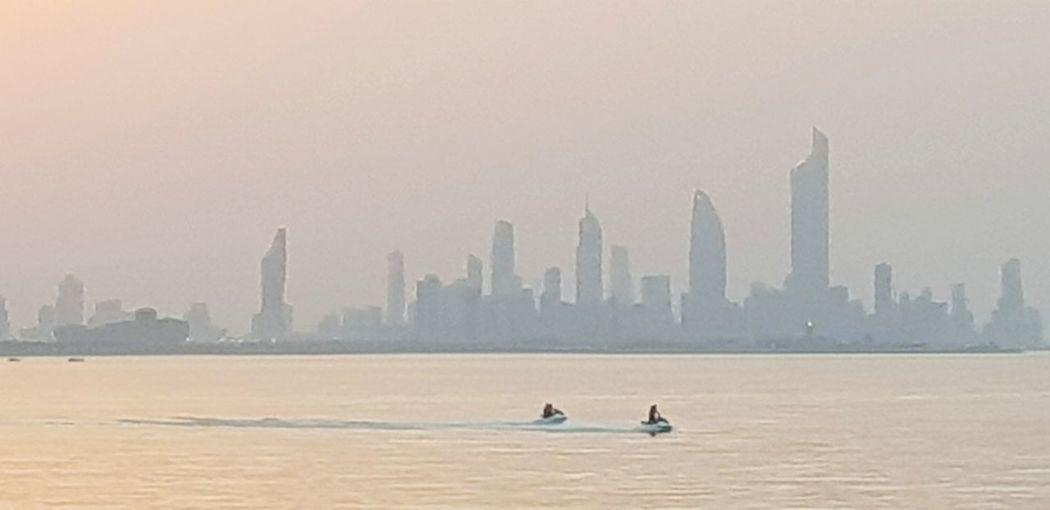 Sunset, Salmiya, Kuwait Bird City Cityscape Urban Skyline Water Skyscraper Sunset Sea Seagull Fog Spread Wings Tall - High Television Tower Sea Bird Tower Black-headed Gull EyeEmNewHere
