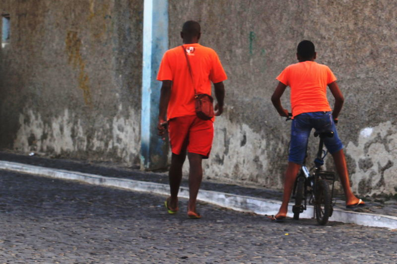 Boy Capo Verde Day Full Length Grey Wall Only Men Orange Color Outdoors People Rear View Sal Island Santa Maria Street Photography Summer 2015 Togetherness Two People