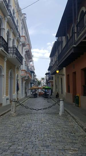 Walking down the streets of Old San Juan. Taking Photos Check This Out Sky And Clouds Architecture No Filter, No Edit, Just Photography Pigeon Old Buildings Red And Blue Puerto Rico Alleyway Alley From My Point Of View Home Is Where The Art Is Hidden Gems