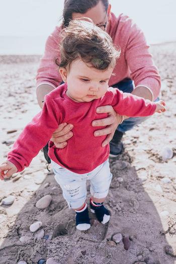 Cute baby girl on beach