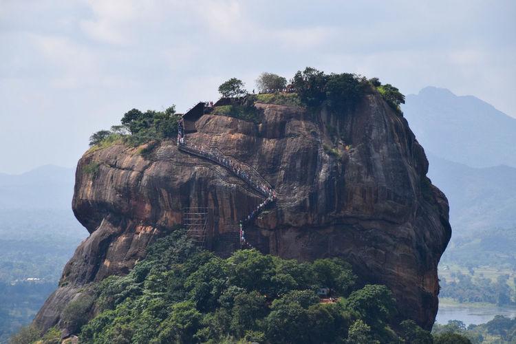 Sigiriya rock Tourist Attraction  Tourists Rock Mountain Tree Sky Rocky Mountains Beauty In Nature