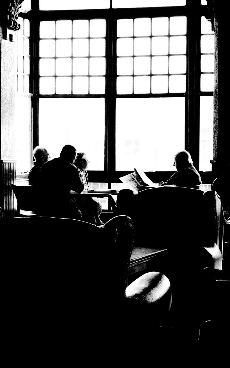window, indoors, real people, men, day, education, sitting, togetherness, women, learning, large group of people, architecture, student, people