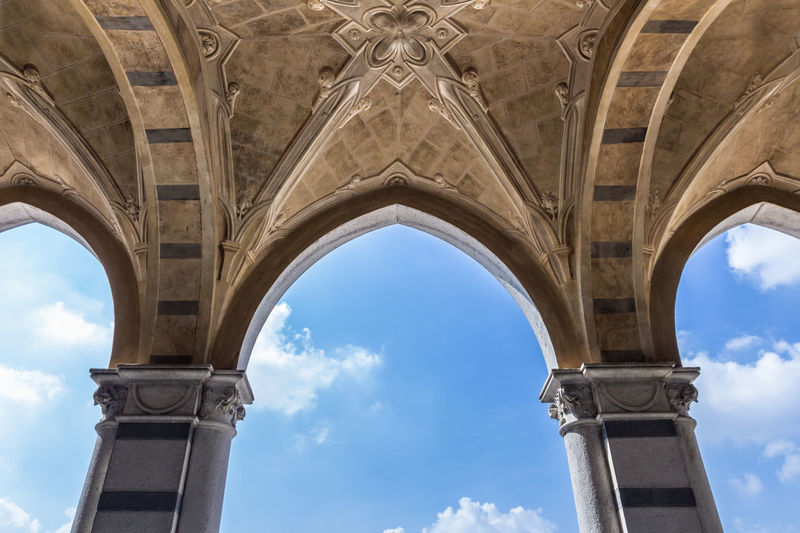 Ancient covered arcade on blue sky background Ancient Architecture Capitals  Ceiling Classic Decor Decorating Exterior Roof Arcade Arches Art Blue Bottom Capital Clouds Column Frame Gallery Landmark Pattern Sky Skyscape Style Stylized