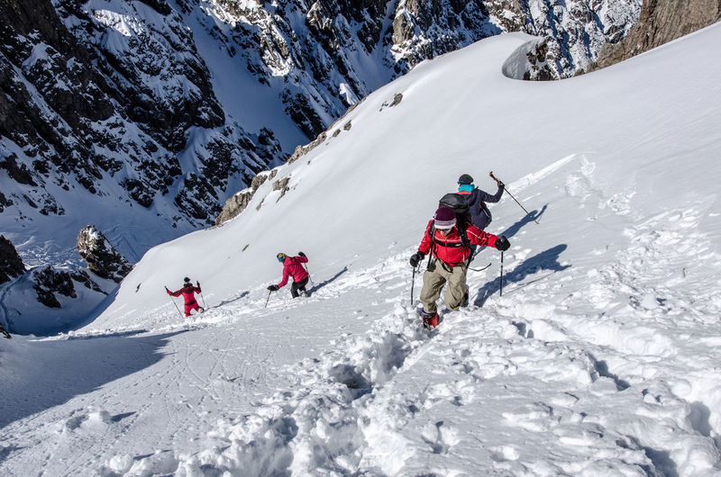 Adult Adults Only Adventure Climbing Cold Temperature Day Extreme Sports Full Length Headwear Karwendel Landscape Mature Adult Mountain Mountaineering Nature Only Men Outdoors People Snow Teamwork Two People Warm Clothing Winter Young Adult