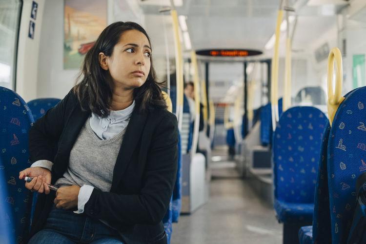 Mid adult man sitting in train