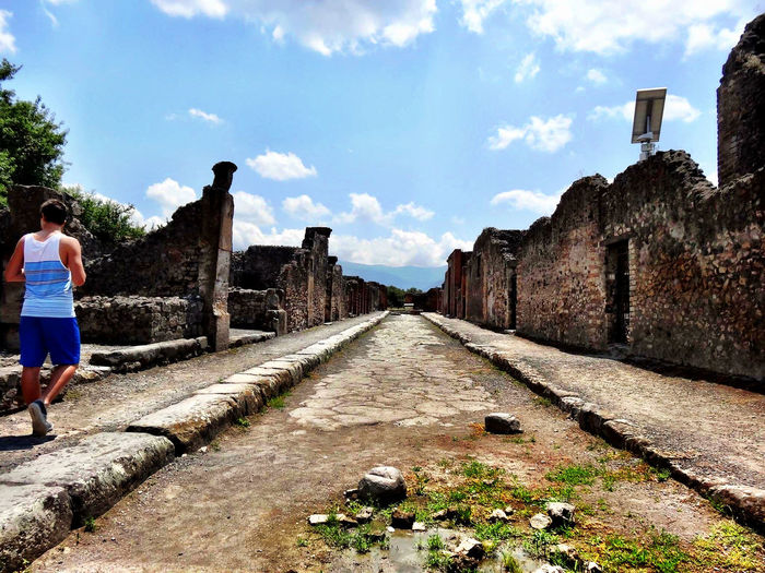 Beauty In Nature Canon Italy Pompeii Details Pompei Scavi Pompeii  Pompéi Sky Architecture Real People Day Rear View Built Structure Nature Lifestyles One Person Building Exterior The Way Forward Walking Outdoors Casual Clothing