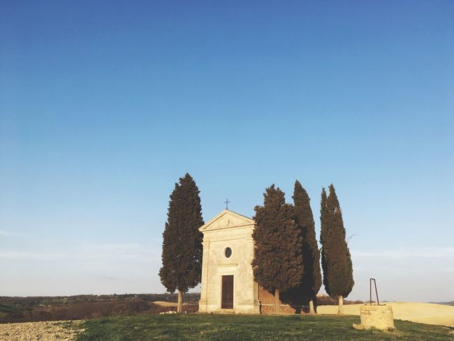 The heart of Italy. Architecture Blue Clear Sky History Building Exterior Built Structure No People Outdoors Nature Ancient Field Tranquility Sky Day Grass Beauty In Nature Landscape Place Of Worship Tree Tuscany Sunset Peace Italy Church Landscape_Collection