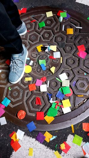 Multi Colored Blue Sneakers New Years Eve 2016 Times Square NYC Just After Midnight Manhole Cover Confetti On The Ground