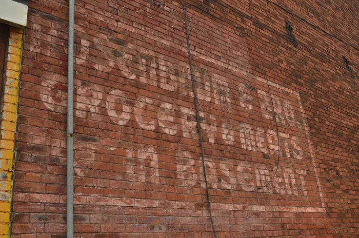 """faded vintage painted sign on old brick building often called """"ghost signs"""" Ghost Sign Ghost Signs  Signs Text Vintage Style Vintage Sign Vintage Signs Architecture Brick Wall Building Exterior Built Structure Close-up Day Lettering No People Outdoors Retro Design"""
