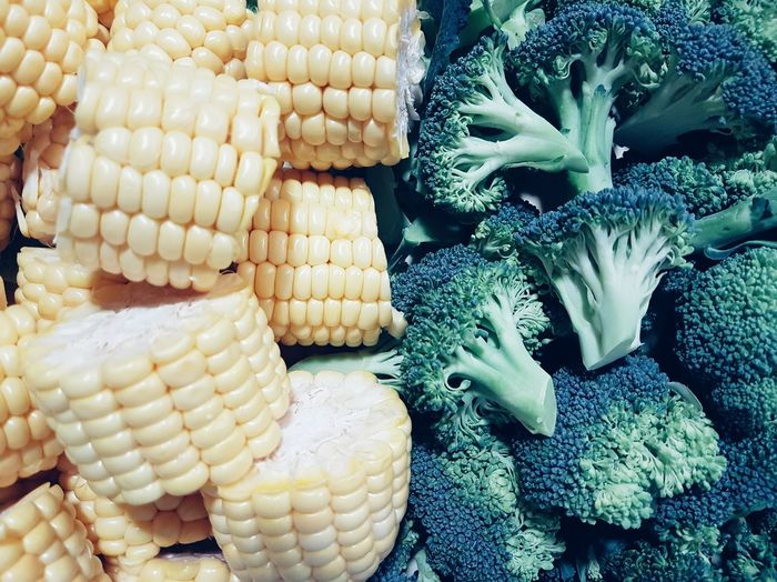 High angle view of broccoli and corns for sale