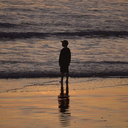 Sea Sunset Water One Person Beach Silhouette Real People Standing Nature Reflection Lifestyles Men Outdoors Beauty In Nature Leisure Activity Wave Tranquility Ankle Deep In Water Sand Scenics California Art Is Everywhere Silhouette Majestic Reflection