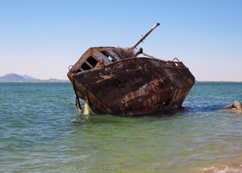 Shrimp boat. Shrimp Boat Nautical Vessel Rusting Scenics Sea Shipwreck Shore Sinking