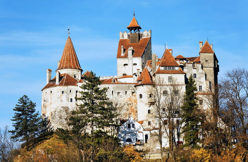 Low angle view of bran castle against sky