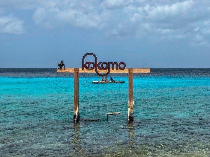 A little place called Kokomo Dutch Caribbean EyeEm Selects EyeEm Best Shots EyeEm Nature Lover Swing Water Sky Sea Cloud - Sky Horizon Nature Horizon Over Water Beauty In Nature Scenics - Nature Blue Beach Waterfront Tranquil Scene Sunlight