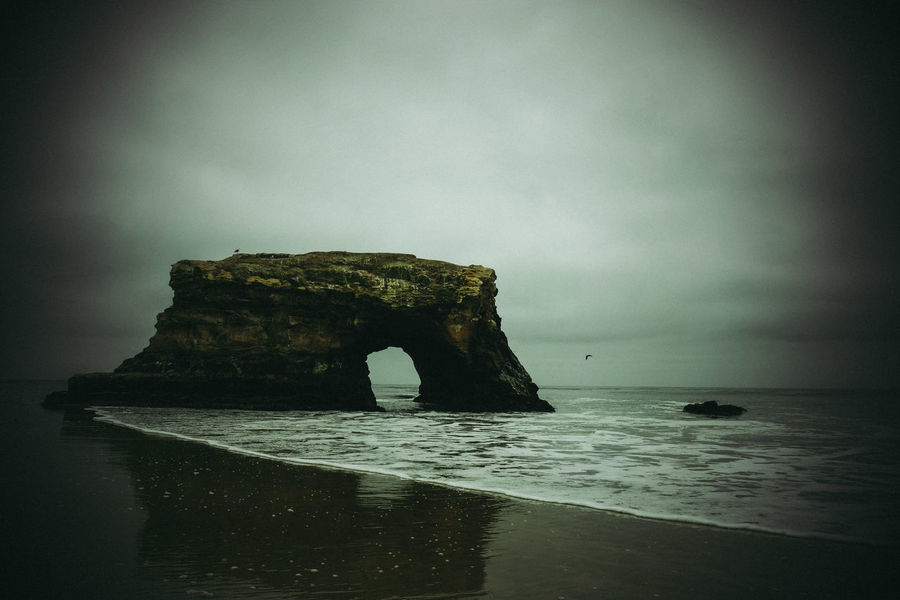 Arch Beauty In Nature Eroded Horizon Horizon Over Water Land Natural Arch Nature No People Outdoors Rock Rock - Object Rock Formation Scenics - Nature Sea Sky Solid Stack Rock Tranquil Scene Tranquility Water Waterfront
