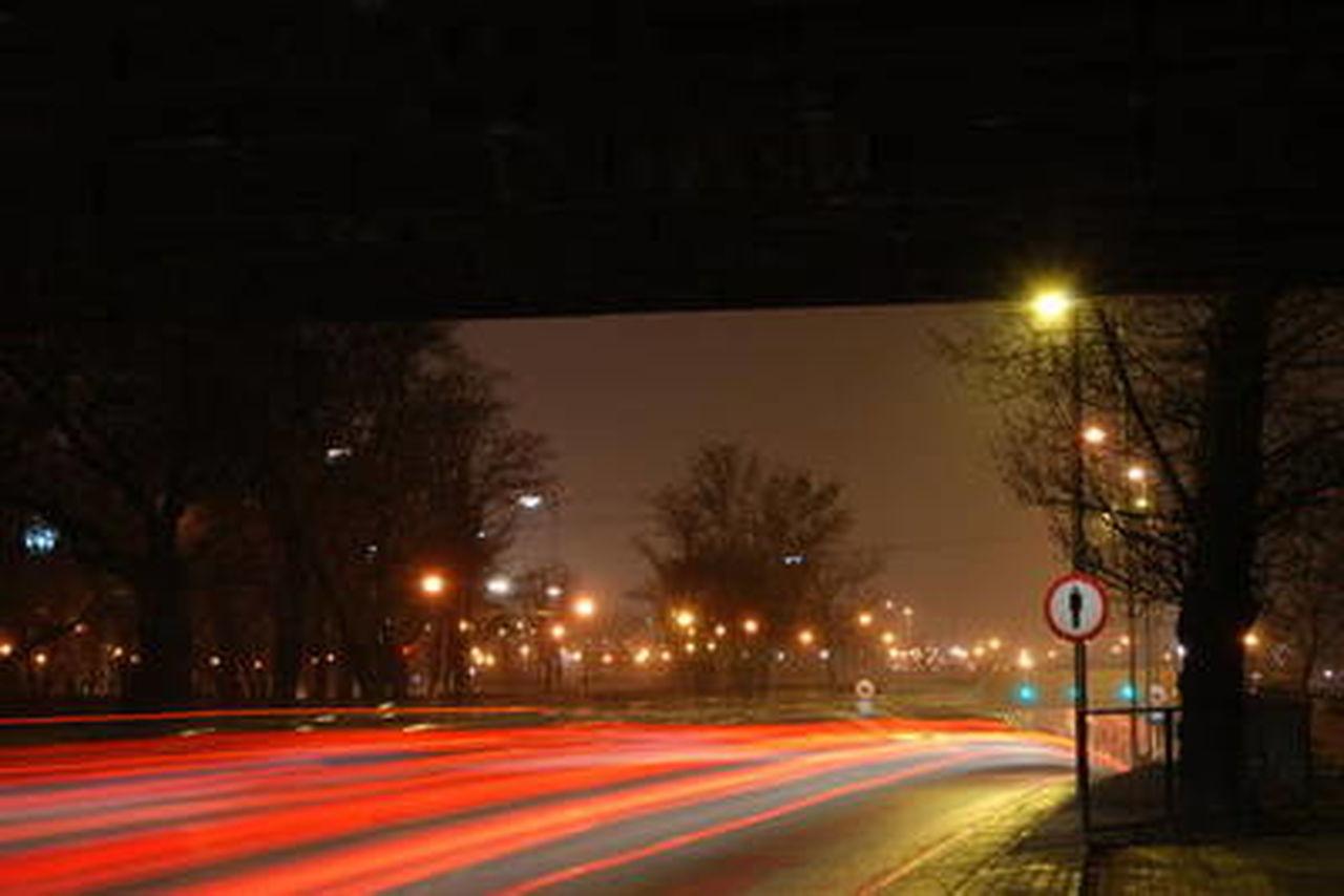 illuminated, night, street light, transportation, light trail, speed, long exposure, road, road sign, no people, stoplight, outdoors, tree, sky