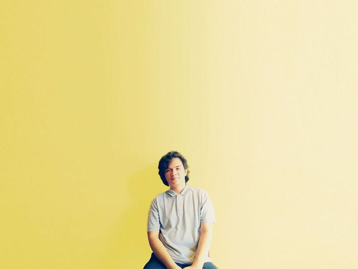 Alone Man Yellow Background Studio Shot Yellow Colored Background Standing Beige Background Copy Space Arts Culture And Entertainment First Eyeem Photo