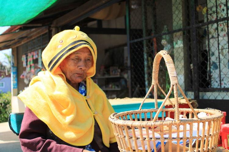 Senoir woman wearing a yellow winter cloth.
