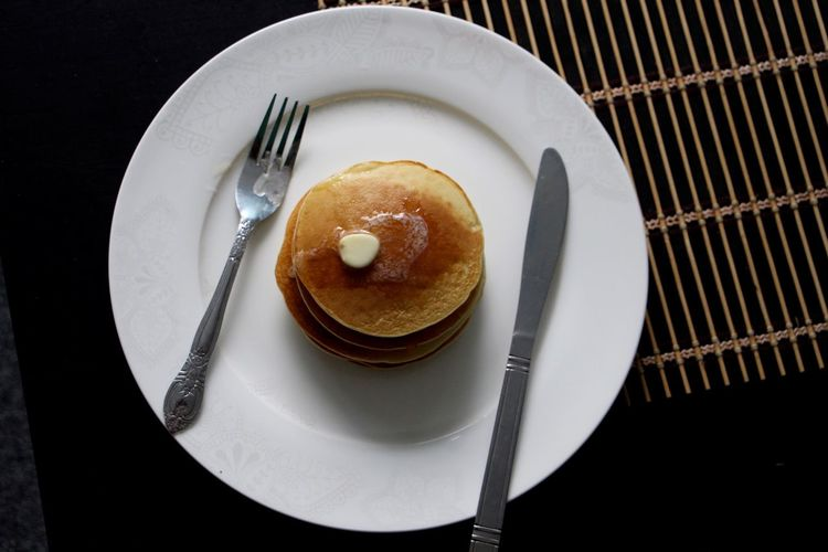 High Angle View Of Butter On Pancake In Plate