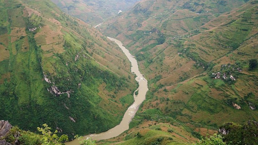 river in the valley of mountains in Ha Giang, Vietnam